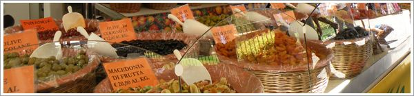 Market shopping Italian-style. Pick up your favorite dried fruits, spices, cheeses, and more. Perfect for a picnic!