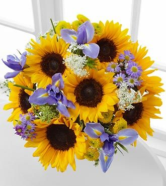 Meant to Shine Sunflower & Iris Bouquet.. I love the combination of flowers.