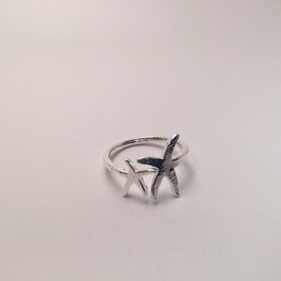 Silver starfish ring New in packaging. Band is adjustable. Metal is zinc alloy. No trades Jewelry Rings