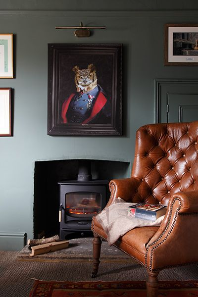 Sitting room in Farrow & Ball Green Smoke with leather armchair