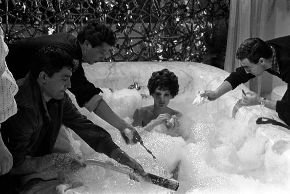Italian actress Rossana Podestà in a bathtub filled with lather on the set of the film Seven Golden Men Strike Again. 1966