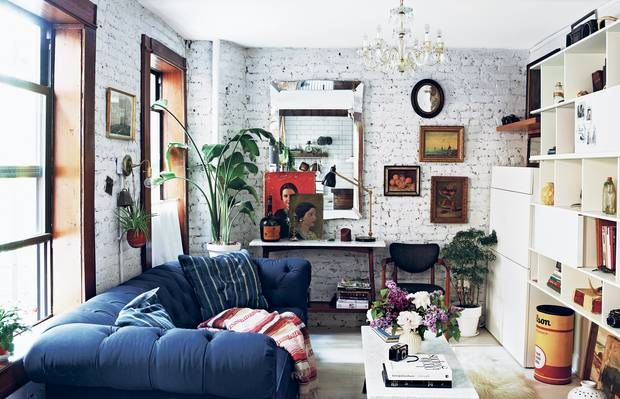 Navy couch and vintage finds in an East Village, NYC apartment
