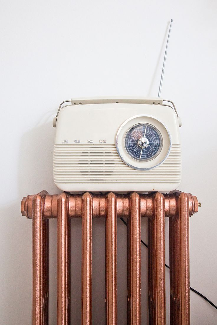 Copper spray painted radiator & vintage radio.