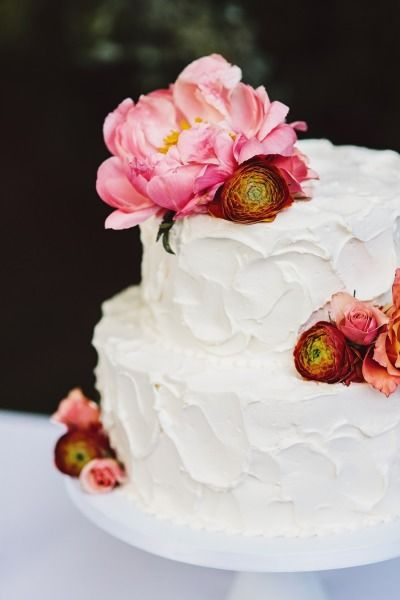 Pretty wedding cake decorated with peonies and ranunculus: http://www.stylemepretty.com/2015/01/12/glamorous-maryland-garden-wedding/   Photography: Sarah Culver - http://www.sarahculver.com/