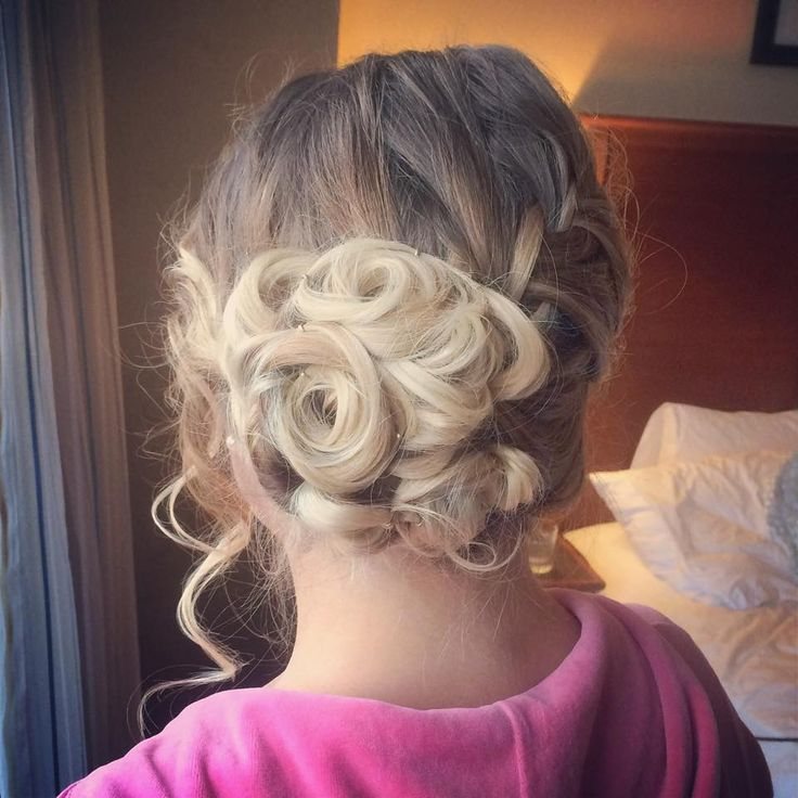 This is hair you did! I love the way you did the braid into the bun. I think if I did something like this, I'd want the bun centered.