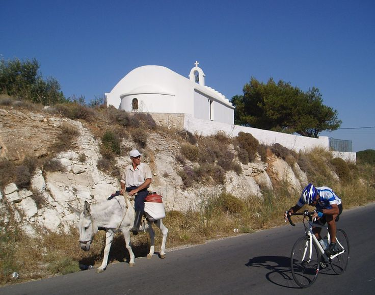 Donkeys are still a popular transport among the local men.  Rarely do women ride. This Naxian's expresses puzzlement watching Rob of New York pedaling hard.
