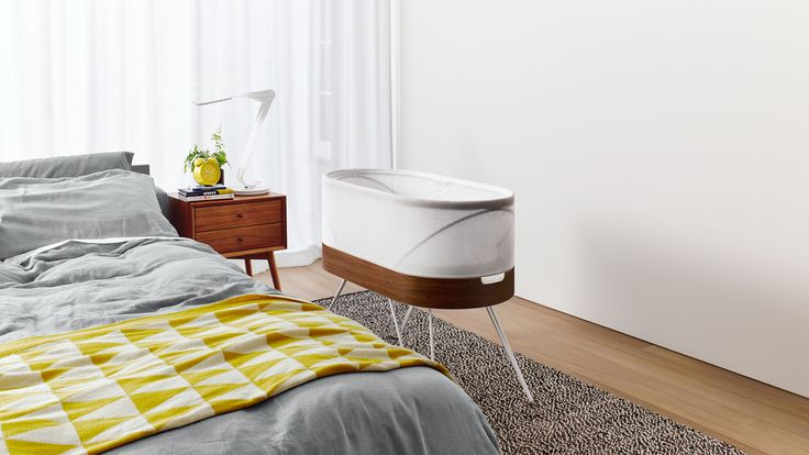 "Parents can stay in bed while this bassinet designed by Yves Behar rocks their babies back to sleep with a ""womb-like motion"" whenever it hears them cry."
