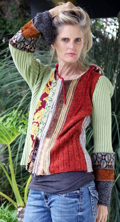 This beautiful jacket is made of chenilles, sweaters, wool, synthethic fur and wood/rope closures. Bright and fun colors. It feels very casual. The