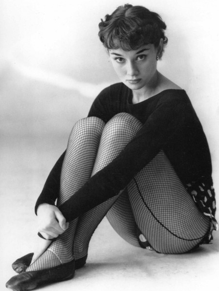 Audrey Hepburn in ballet shoes, looking demure and minxy at the same time...that's a skill.