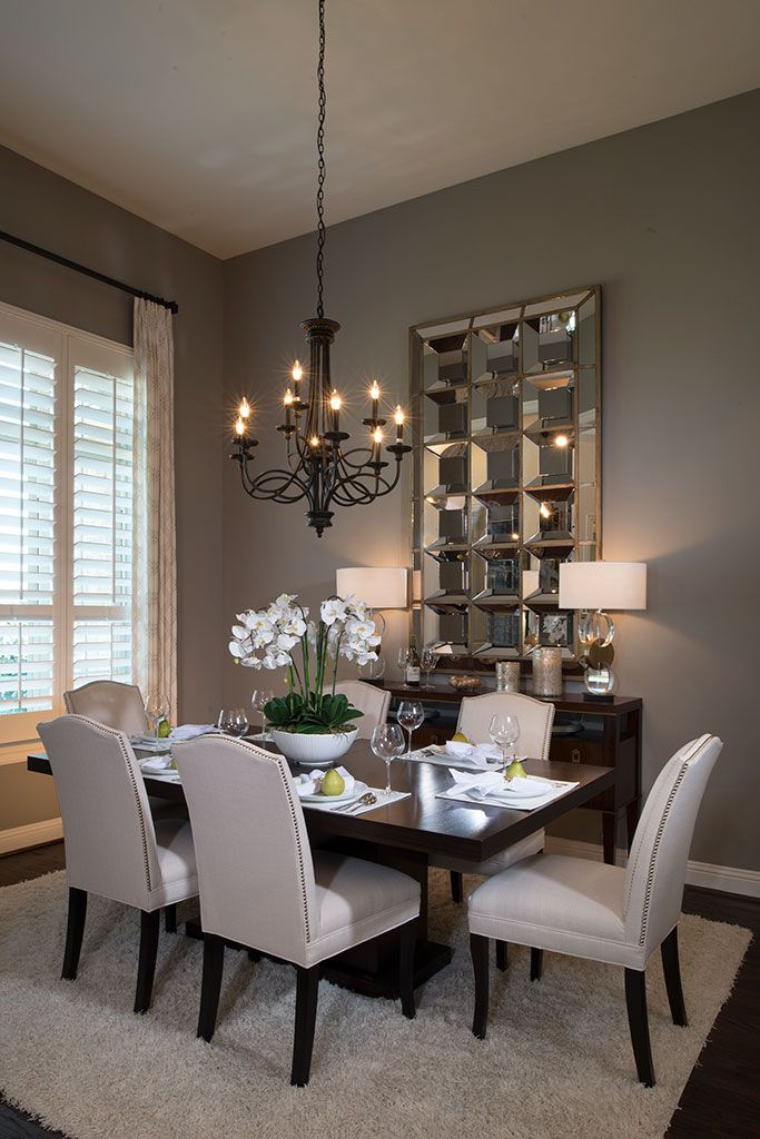Highland Homes black chandelier contrasting dining
