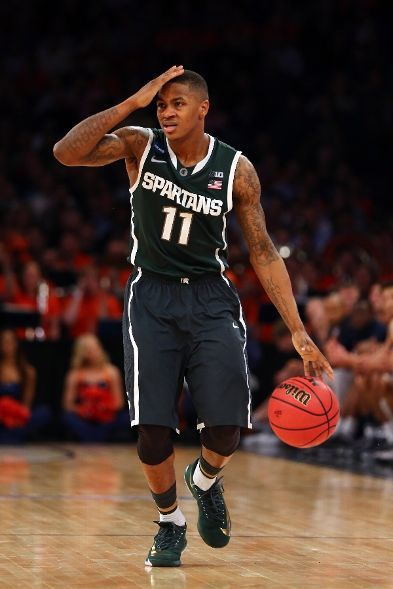 Keith Appling #11 of the Michigan State Spartans gestures as he bring the ball up the court against the Virginia Cavaliers during the regional semifinal of the 2014 NCAA Men's Basketball Tournament at Madison Square Garden on March 28, 2014 in New York City. (Photo by Elsa/Getty Images)