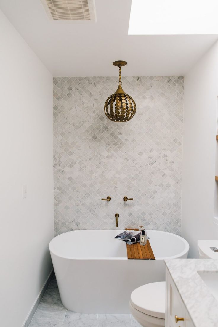 Prettiest white bathroom and freestanding tub for a small bath