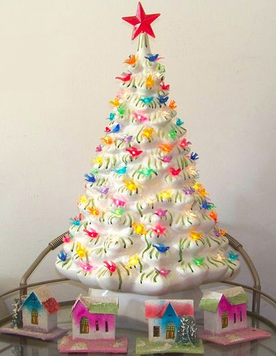I have SO much love for ceramic Christmas Trees. They remind me of my Granny. I covet a white tree...! Ours is green.