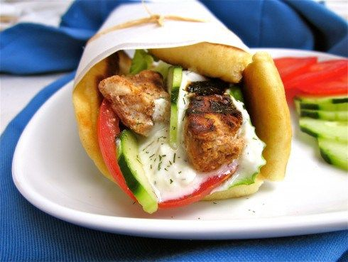 Chicken Shawarma with yummy Greek yogurt sauce all wrapped up in soft naan bread. Yum!