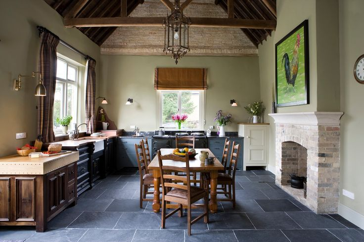 Beautiful brick fireplace mantels in Kitchen Farmhouse with Slate Appliance next to French Country Kitchen Ideas alongside Sage Green and Gray Tile Floor
