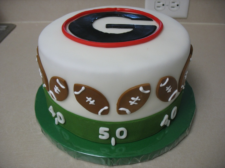 First Groom's cake - This was a little different design from my previous Georgia cake.  This was my first order for a groom's cake and it was a 2 hour drive for the delivery.  Thank goodness it made it fine.  Covered in fondant with fondant accents and royal icing for the lacing on the footballs.