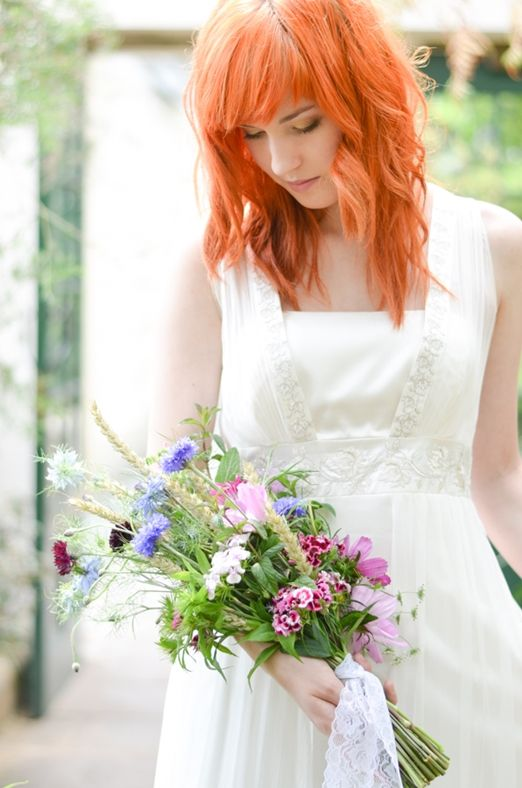 Natural meadow style bridal bouquet with wheat and cornflowers