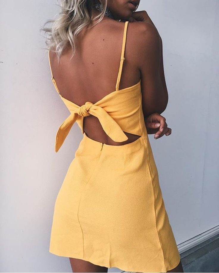 The trend colour this season is yellow and this pretty vibrant summer dress is too die for.