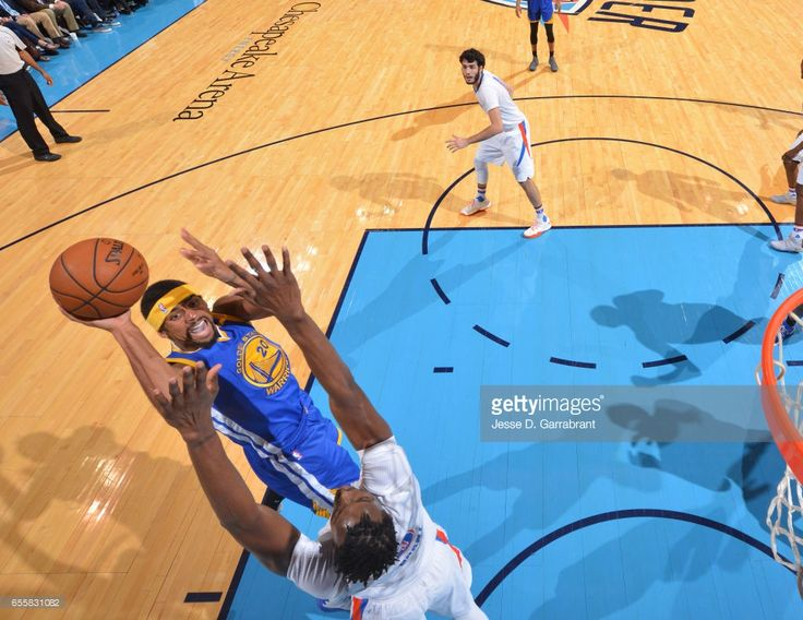 James Michael McAdoo #20 of the Golden State Warriors goes up for the layup against the Oklahoma City Thunder during the game on March 20, 2017 at Chesapeake Energy Arena in Oklahoma City, Oklahoma