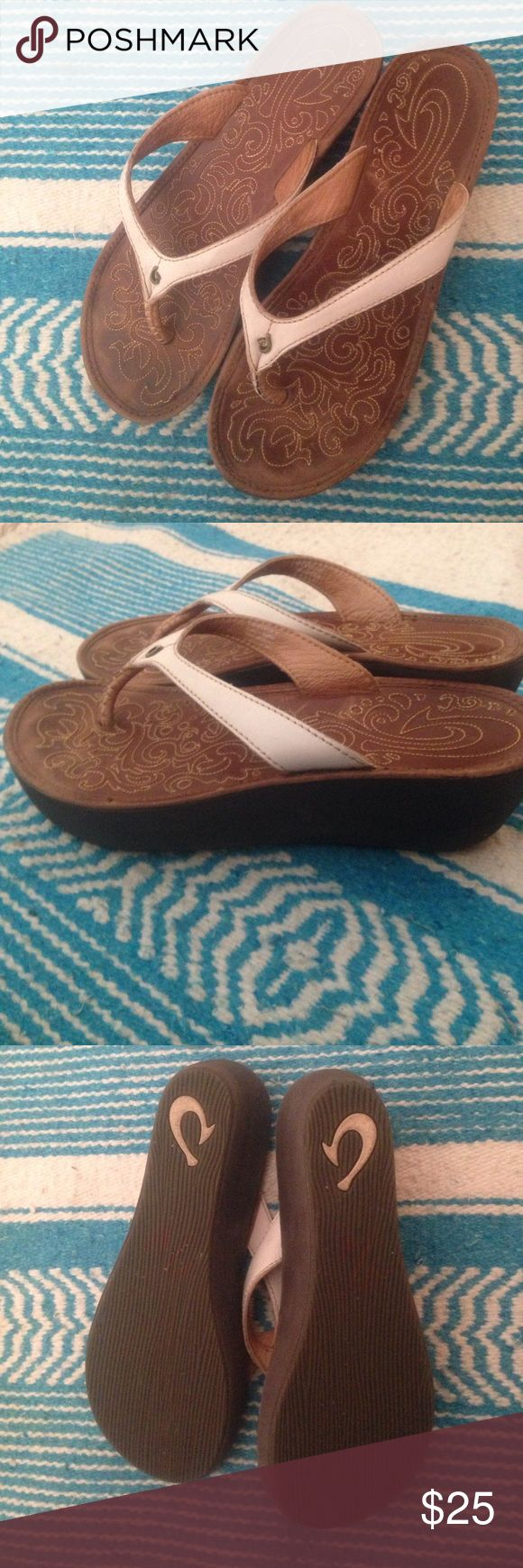 Olukai Wedge Sandal These sandals are is really good condition. There is only one scuff on the back of the wedge (see photo). They have minimal wear on the bottom! They have gorgeous white leather straps with the iconic Olukai detailing on the footbed. OluKai Shoes Sandals