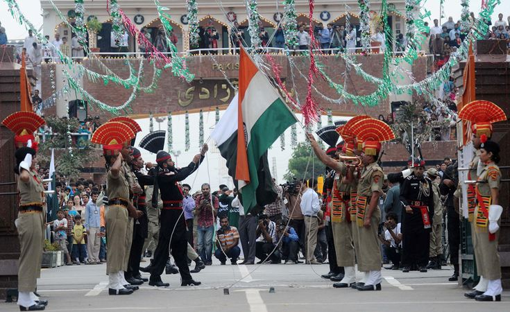 Pakistani Rangers (black) and Indian Border Security Force personnel (brown) perform the flag off ceremony at India-Pakistan Wagah Border Post on Aug. 14. Pakistan celebrates Independence Day on August 14 and India on August 15. (Narinder Nanu/AFP/Getty Images)