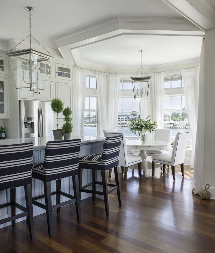 White kitchen with navy and white striped bar stools.