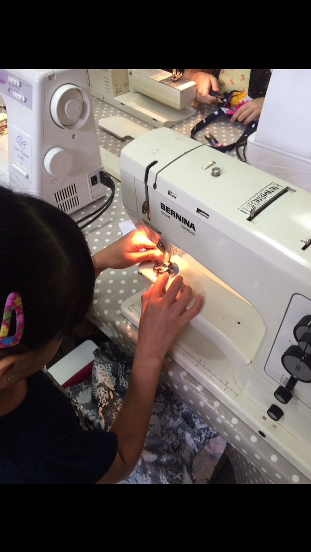 Kids sewing away
