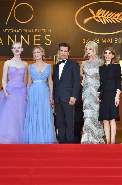 Elle Fanning Photos Photos - (From L) US actress Elle Fanning, US actress Kirsten Dunst, Irish actor Colin Farrell, Australian-US actress Nicole Kidman and US director Sofia Coppola pose as they arrive on May 24, 2017 for the screening of the film 'The Beguiled' at the 70th edition of the Cannes Film Festival in Cannes, southern France.  / AFP PHOTO / LOIC VENANCE - 'The Beguiled' Red Carpet Arrivals - The 70th Annual Cannes Film Festival