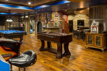 Man cave with foosball, pool table and arcade games