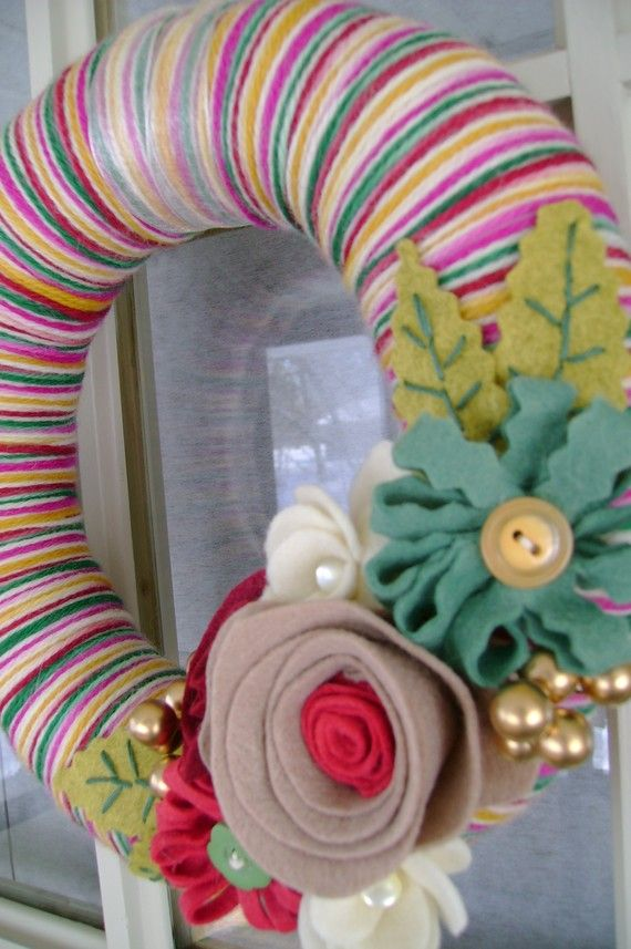 Felt and yarn wreath from Etsy.  I like the flowers and leaves.