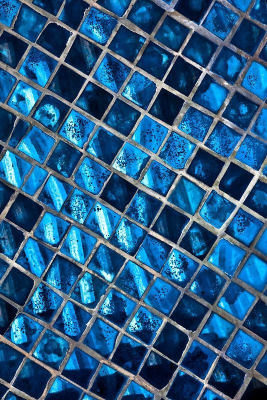 Beautiful mosaic wall in shades of blue.