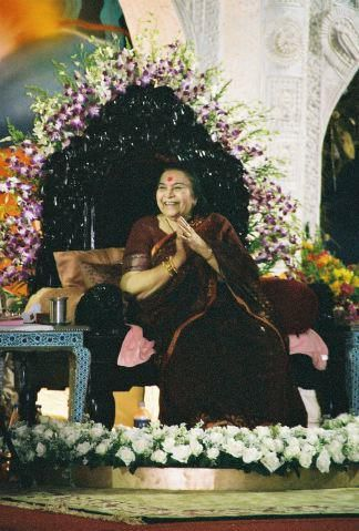 Om Shri Devi   Shri Mataji enjoying a performance at Ganapatipule, Christmas 2003