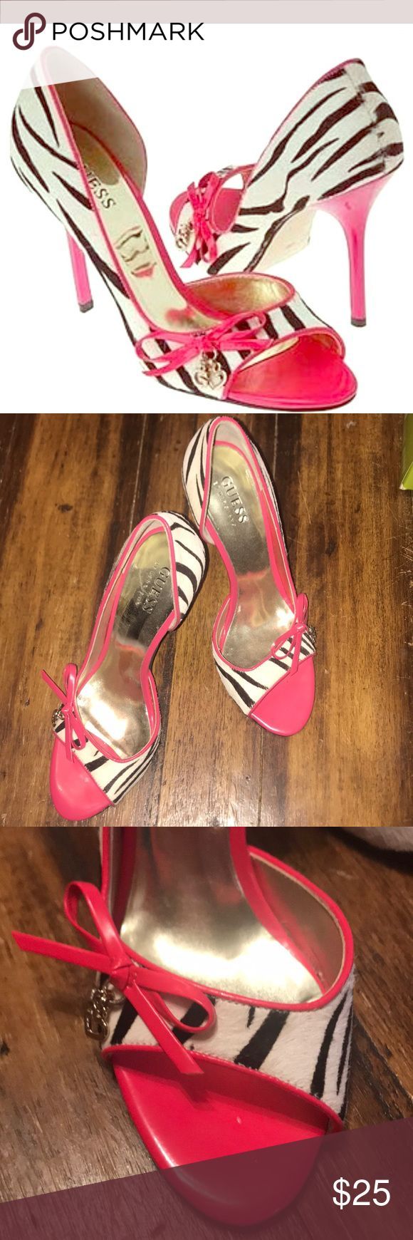 Hot pink and Zebra heels Size 6.5 Guess heels. Zebra pint and hot pink. Bottoms are scuffed from walking in them. I do have the original box. Guess Shoes Heels