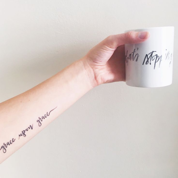 Grace Upon Grace forearm script tattoo.