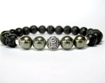 A stylish Beaded Onyx Bracelet with a Tiger Eye feature bead.  For this Mens Beaded Bracelet I have used Grade A 10mm Black Onyx beads and created a feature and focal point using a single 10mm Grade A Tiger Eye bead. A versatile and masculine bracelet, great to wear on its own.  This bracelet is available in several size options, please select the bracelet size from the listing.