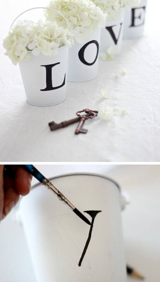 L-O-V-E Tin Pail Flower Arrangement | Click Pic for 25 DIY Wedding Decorations on a Budget | DIY Rustic Wedding Decor Ideas on a Budget