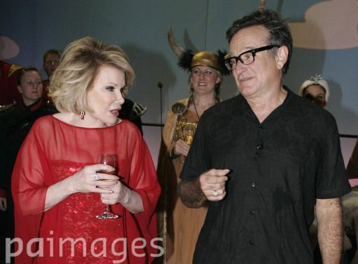 US actors and comedians Joan Rivers and Robin Williams backstage at the Wimbledon Theatre, London, after a charity performance in aid of the Prince's Trust charity, one of a number of events to celebrate the Prince of Wales's 60th birthday on November 14.