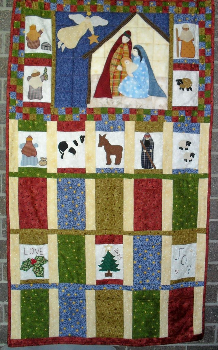 Christmas Calendar wall hanging with pockets large enough to hold nativity figures.
