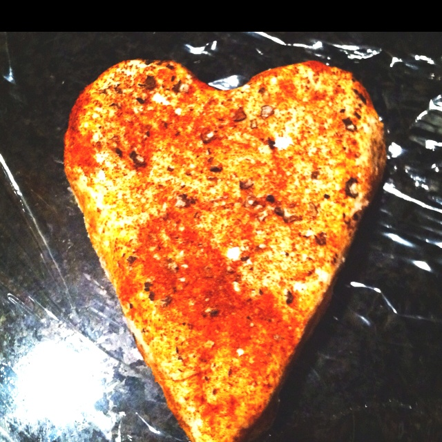 Goat cheese shaped into a Valentine heart, sprinkled with paprika and ...