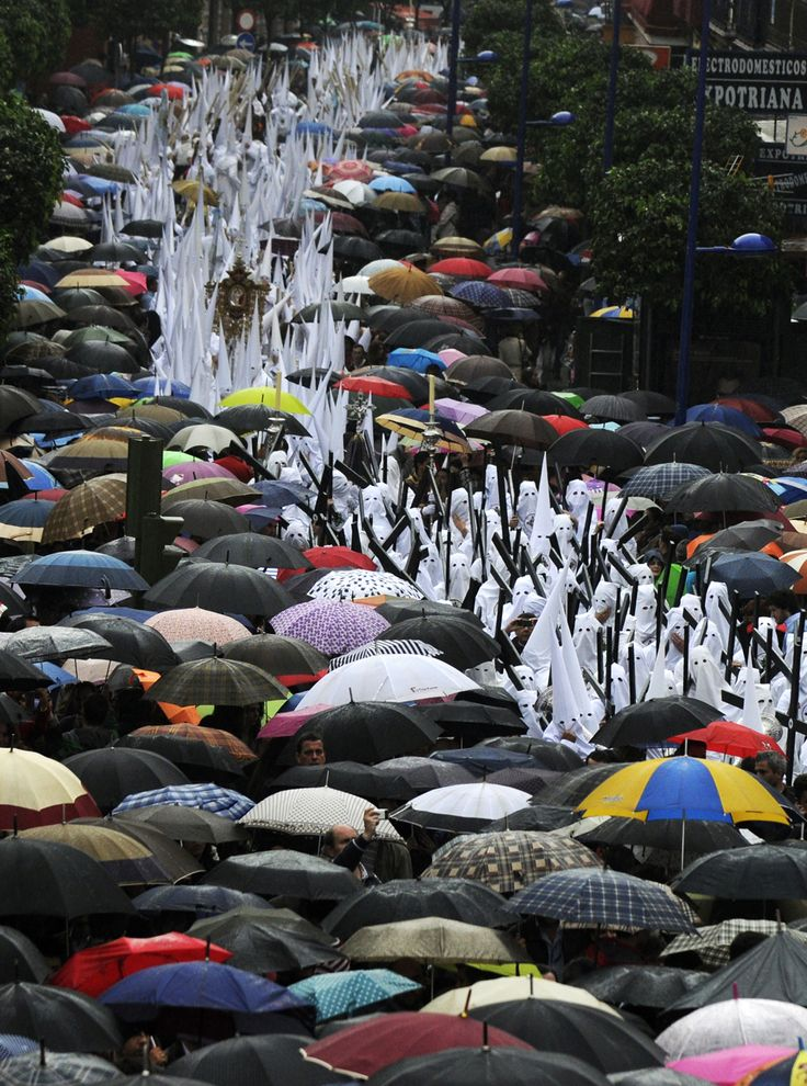 """Penitents of 'San Gonzalo' parade during Holy Week in Seville on April 2, 2012. (Cristina Quicler/AFP/Getty Images)""  Easter and Holy Week, The Big Picture.  http://www.boston.com/bigpicture/2012/04/easter_and_holy_week.html"