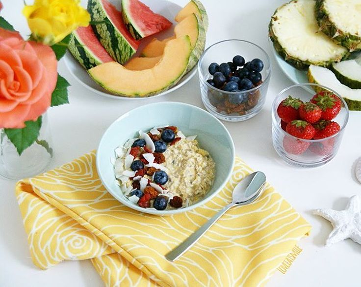 Tropical Coconut-Oatmeal with Maca and loads of fruits and berries
