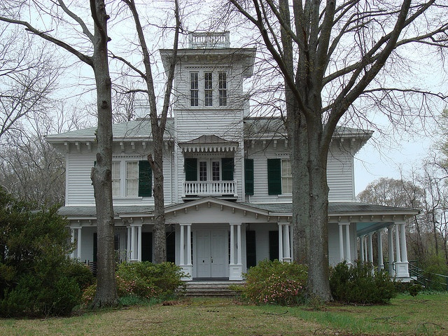"""Ten Oaks,"" built in 1850, was the largest house in Calhoun County, AL, at the time. It was built by Mr. and Mrs. James Crook. General Beauregard stood on the front balcony to be serenaded by the people of Jacksonville. The house was his headquarters in October 15-23, 1864."