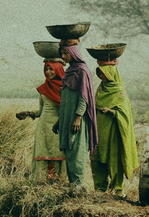 Balancing act, rural Punjab. hard working women.