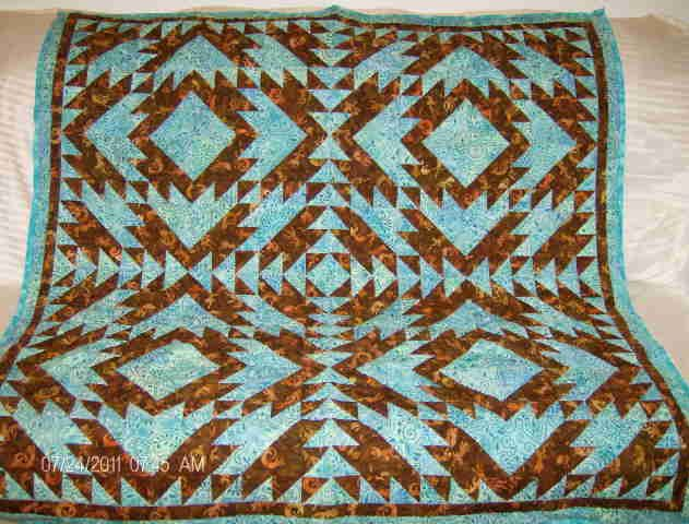 Turquoise and Brown Southwestern quilt.