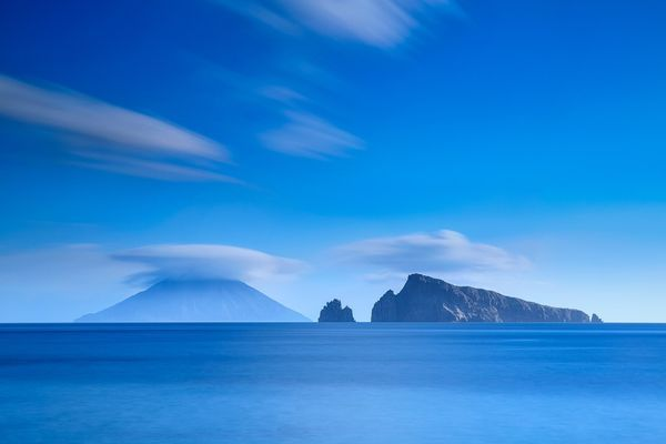 Stromboli, Italy The iconic Mt. Stromboli is one of the live volcanoes in Italy. It has an unique constant eruption pattern which occurs roughly every 20 mins and has done so for the past 2000 years. The UFO disk shape of cloud appears on top of Mt. Stromboli in this picture is due to the cooler air condensing when passing over the hot volcano.