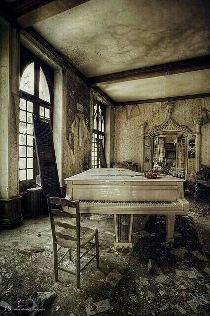 Abandoned, great piano and fabulous mirror on the back wall.