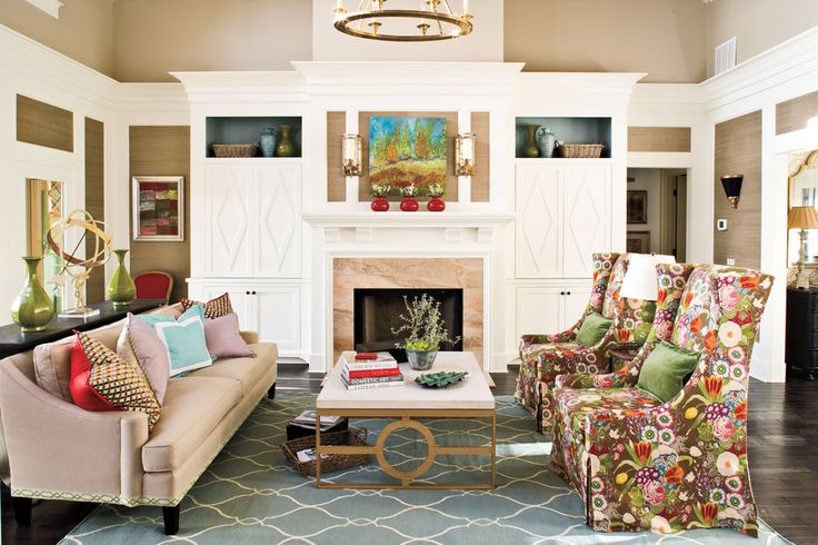 The designer of this room added trim to the bottom of a basic sofa to dress it up and used a mix of custom pillows to pull colors from around the room.  See this Georgia Mountain Home