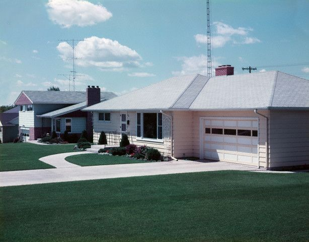 Photograph of a suburban home in Crookston, Minnesota, 1957, by O. Johnson. (via Corbis)