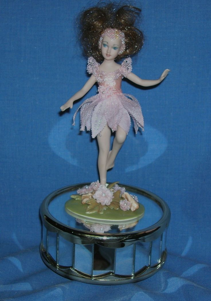 Porcelain dolly by my sister Moonyean, dressed in lace by me.