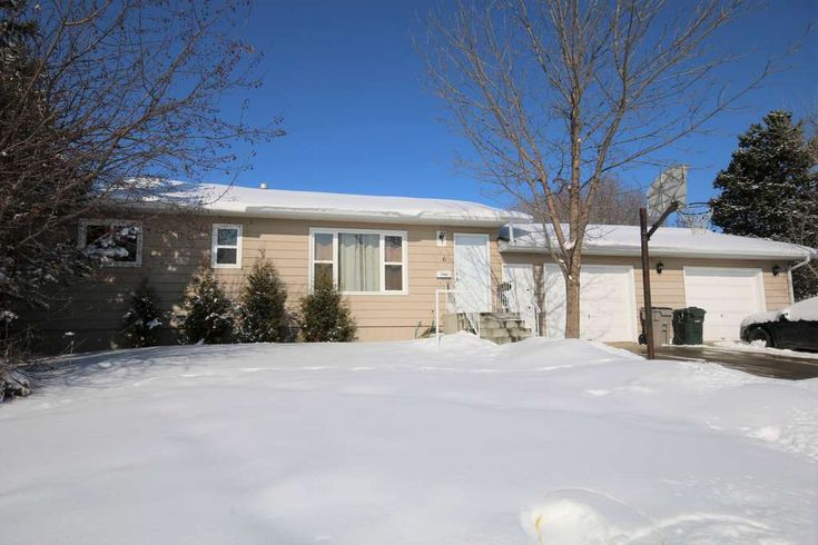 ATTRACTIVE BUNGALOW ON LARGE CORNER LOT IN STONY PLAIN. For more information got to www.6GlendaleCr.info